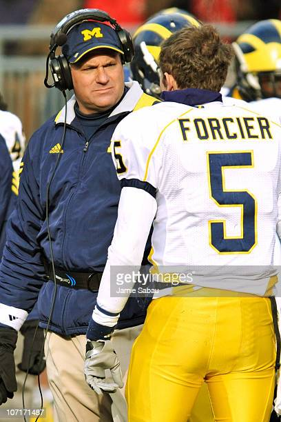 Head Coach Rich Rodriguez of the Michigan Wolverines talks to quarterback Tate Forcier of the Michigan Wolverines during a game against Ohio State...