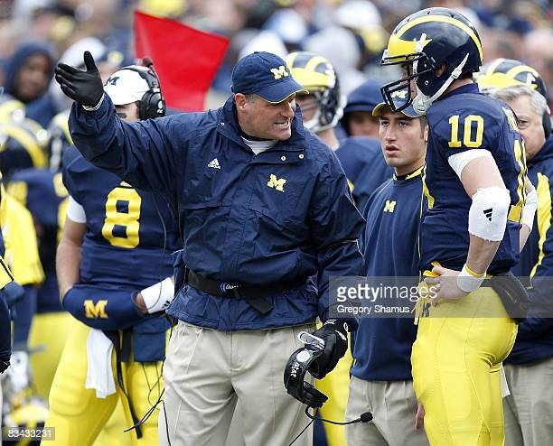 Head coach Rich Rodriguez of the Michigan Wolverines talks with Steven Threet while playing the Michigan State Spartans on October 25, 2008 at...
