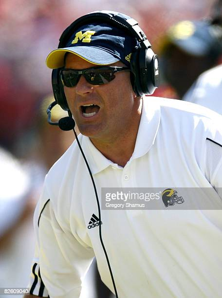 Head coach Rich Rodriguez of the Michigan Wolverines yells from the sideline during the first quarter while playing the Utah Utes on August 30, 2008...