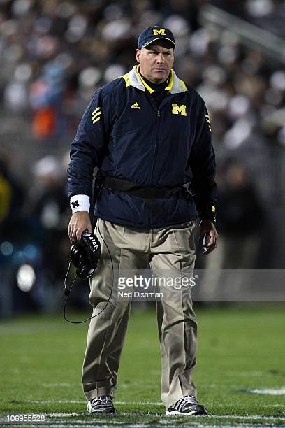 Head coach Rich Rodriguez of the University of Michigan Wolverines on the field against the Penn State Nittany Lions at Beaver Stadium on October 30...
