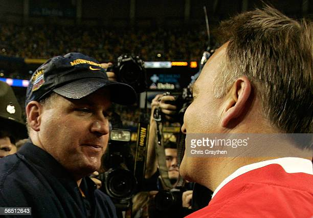 Head coach Rich Rodriguez of the West Virginia Mountaineers shakes hands with head coach Mark Richt of the Georgia Bulldogs after winning 3835 in the...