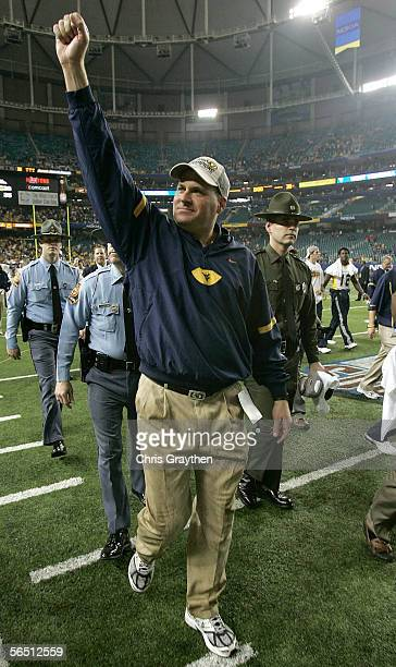 Head coach Rich Rodriguez of the West Virginia Mountaineers walks off the field after defeating the Georgia Bulldogs 3835 in the Nokia Sugar Bowl at...