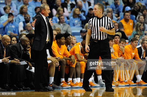 Head coach Rick Barnes of the Tennessee Volunteers speaks with a referee during their game against the North Carolina Tar Heels at Dean Smith Center...