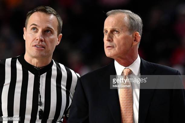 Head coach Rick Barnes of the Tennessee Volunteers talks with an official during the Volunteers' basketball game against the Georgia Bulldogs at...