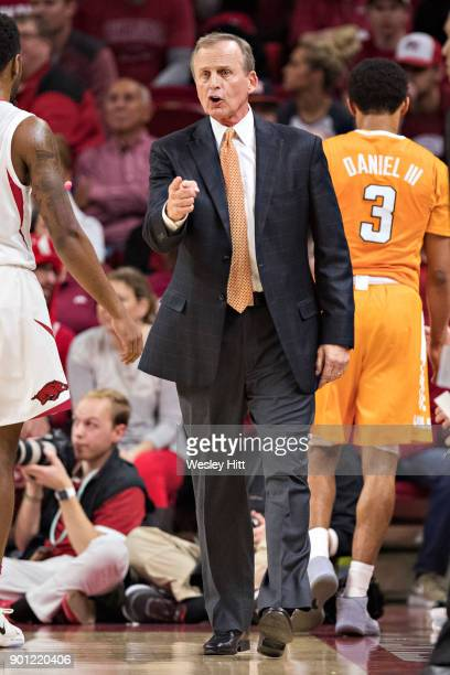 Head Coach Rick Barnes of the Tennessee Volunteers yells to his team during a game against the Arkansas Razorbacks at Bud Walton Arena on December 30...