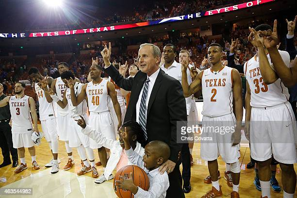 Head coach Rick Barnes of the Texas Longhorns and his team flash the Hook 'em Horns sign after defeating the TCU Horned Frogs at the Frank Erwin...