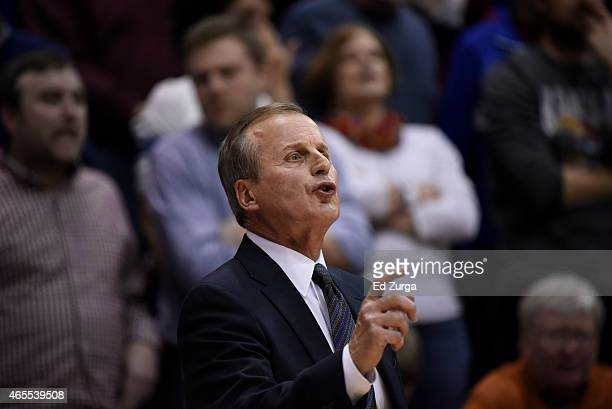 Head coach Rick Barnes of the Texas Longhorns calls in plays during a game against the Kansas Jayhawks at Allen Fieldhouse on February 28 2015 in...