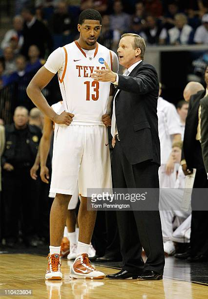Head coach Rick Barnes of the Texas Longhorns speaks with Tristan Thompson during the second round game against the Oakland Golden Grizzlies in the...