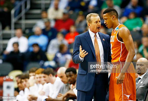 Head coach Rick Barnes of the Texas Longhorns talks to Demarcus Holland in the first half against the Butler Bulldogs during the second round of the...