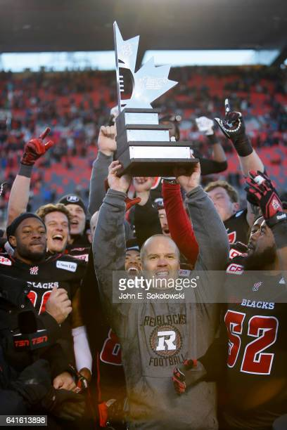Head coach Rick Campbell of the Ottawa REDBLACKS hoists the East Division trophy after winning the CFL Eastern Final Playoff game against the...