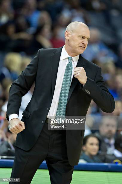Head Coach Rick Carlisle of the Dallas Mavericks shows how his player was fouled during a game against the Memphis Grizzlies at the FedEx Forum on...