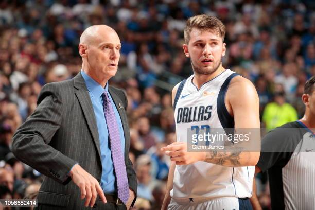 Head Coach Rick Carlisle talks with player Luka Doncic of the Dallas Mavericks during the game against the Minnesota Timberwolves on October 20 2018...