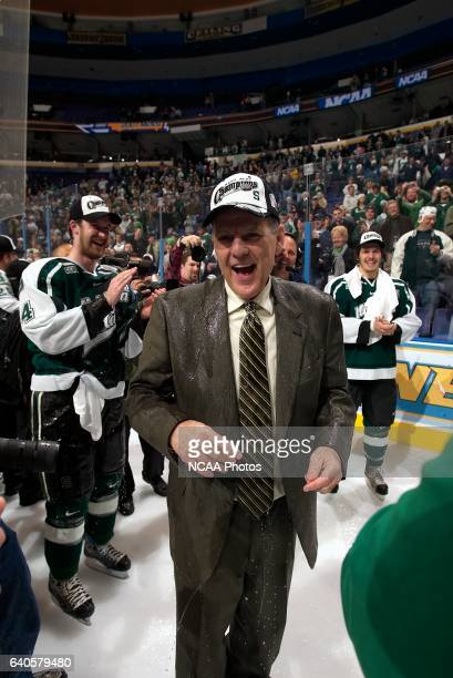 Head Coach Rick Comley of Michigan State was drenched by his players during the celebration after the Division I Men's Ice Hockey Championship held...