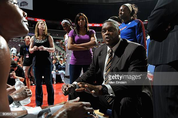 Head coach Rick Mahorn of the Detroit Shock huddles with his players during the WNBA game against the New York Liberty on September 10, 2009 at The...