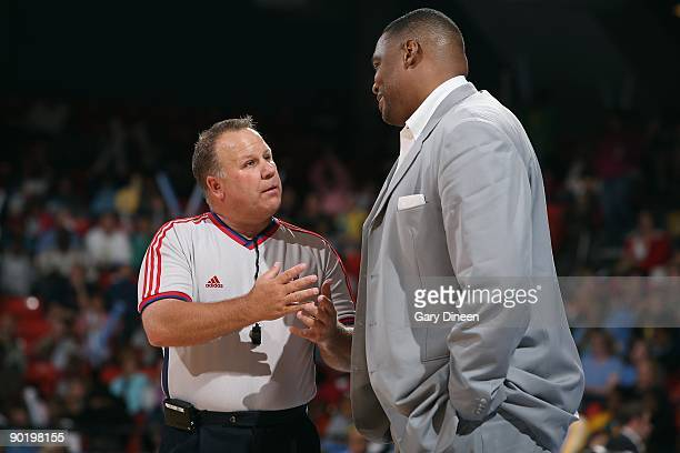 Head coach Rick Mahorn of the Detroit Shock talks with referee Tom Mauer during the game against the the Chicago Sky on August 22, 2009 at the UIC...