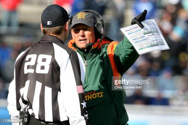 Head coach Rick Neuheisel of Arizona Hotshots speaks with an official during their Alliance of American Football game against the Salt Lake Stallions...