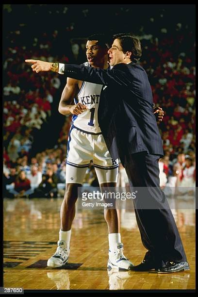 Head coach Rick Pitino of the Kentucky Wildcats talks with a player during a Wildcats bame at Rupp Arena in Lexington Kentucky