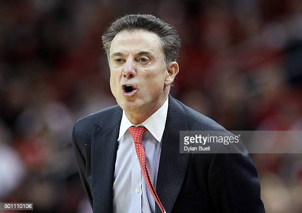 Head coach Rick Pitino of the Louisville Cardinals calls out instructions during the first half against the Eastern Michigan Eagles at KFC YUM Center...