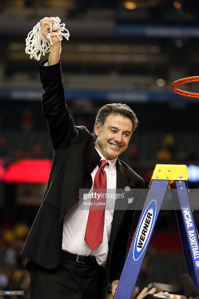 Head coach Rick Pitino of the Louisville Cardinals celebrates with the net after cutting it down following their 82-76 win against the Michigan Wolverines during the 2013 NCAA Men's Final Four Championship at the Georgia Dome on April 8, 2013 in Atlanta, Georgia.