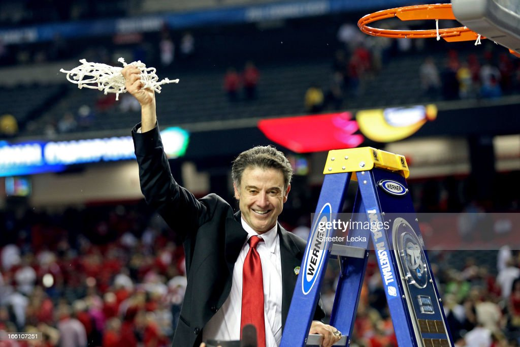 Head coach Rick Pitino of the Louisville Cardinals celebrates with the net after they won 82-76 against the Michigan Wolverines during the 2013 NCAA Men's Final Four Championship at the Georgia Dome on April 8, 2013 in Atlanta, Georgia.