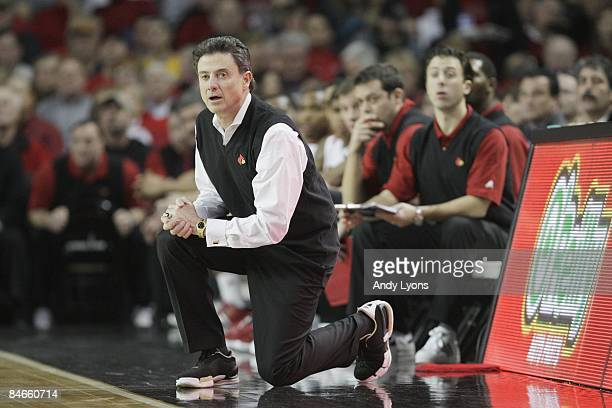 Head coach Rick Pitino of the Louisville Cardinals looks on against the West Virginia Mountaineers during the Big East Conference game on January 31,...