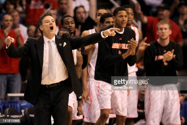 Head coach Rick Pitino of the Louisville Cardinals reacts in front of the bench late in the second half while taking on the Florida Gators during the...