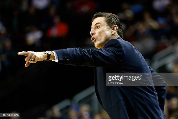 Head coach Rick Pitino of the Louisville Cardinals signals in the first half of the game against the Northern Iowa Panthers during the third round of...