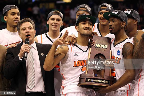 Head coach Rick Pitino Peyton Siva and Russ Smith of the Louisville Cardinals celebrate after defeating the Florida Gators 7268 during the 2012 NCAA...