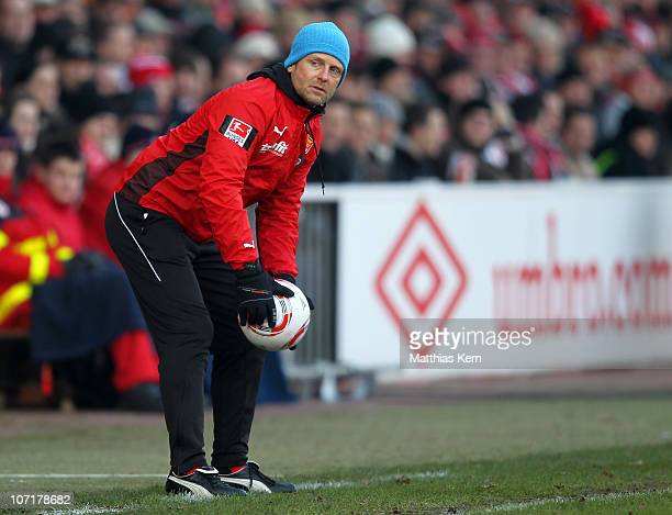 Head coach Rico Schmitt of Aue holds the ball during the Second Bundesliga match between FC Energie Cottbus and Erzgebirge Aue at Stadion der...