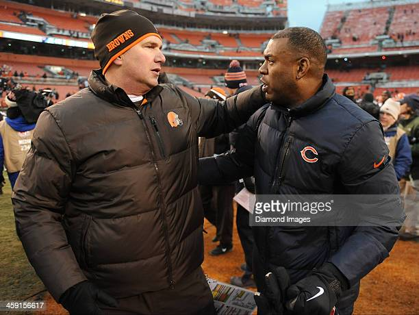 Head coach Rob Chudzinski of the Cleveland Browns and defensive coordinator Mel Tucker of the Chicago Bears shake hands after a game between the...