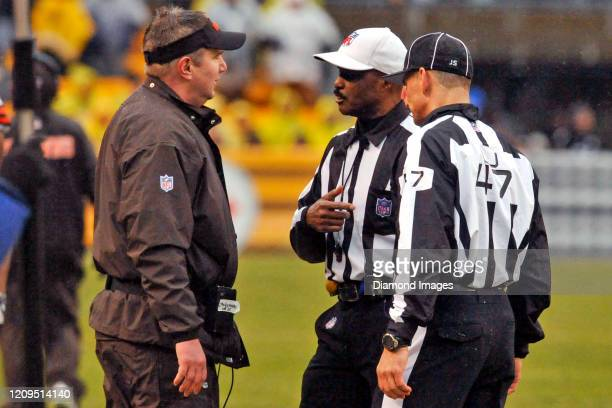 Head coach Rob Chudzinski of the Cleveland Browns talks with referee Mike Carey in the third quarter of a game against the Pittsburgh Steelers on...