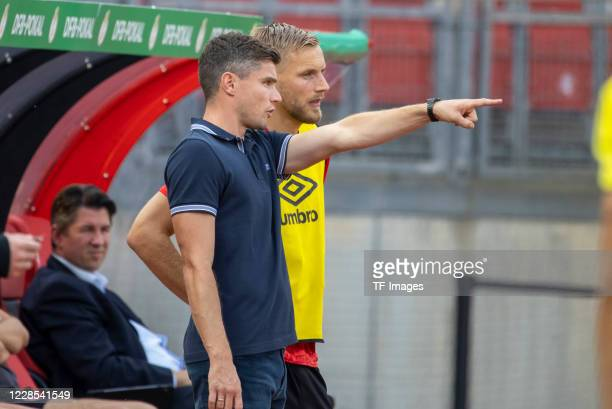 head coach Robert Klauss of 1FC Nuernberg and Hanno Behrens of 1FC Nuernberg during the DFB Cup first round match between 1 FC Nuernberg and RB...