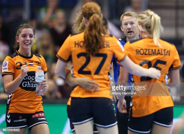 Head coach Robert Nijdam of The Netherlands gives instructions to Anouk Zwinkels Dione Housheer and Charris Rozemalen of The Netherlands during the...