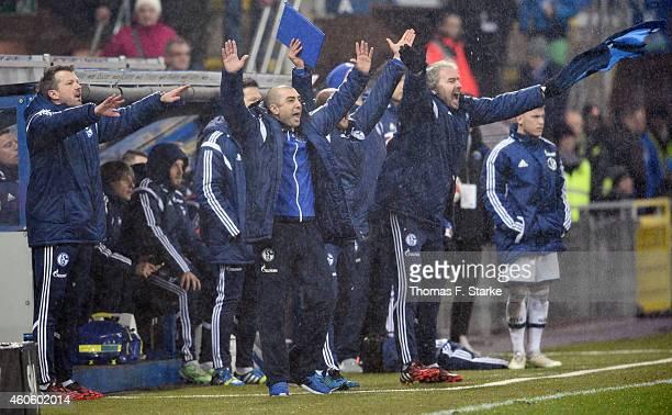 Head coach Roberto Di Matteo of Schalke and his stuff members celebrate during the Bundesliga match between SC Paderborn and FC Schalke 04 at...