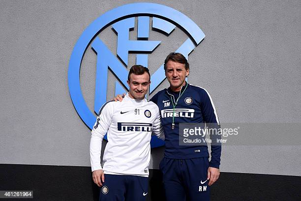 Head coach Roberto Mancini and Xherdan Shaqiri pose for a photoeprior to the FC Internazionale Training Session at Appiano Gentile on January 10 2015...