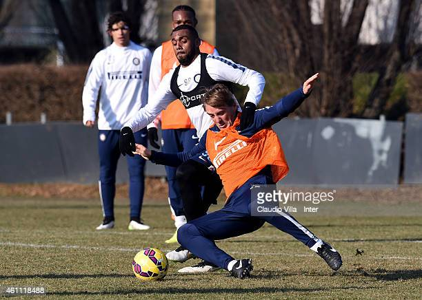 Head coach Roberto Mancini and Yann M'Vila compete for the ball during the FC Internazionale Training Session at Appiano Gentile on January 07, 2015...