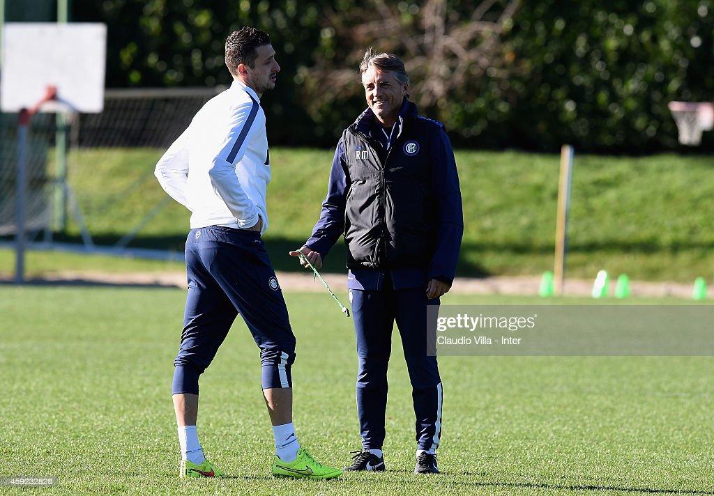 Head coach Roberto Mancini (R) and Zdravko Kuzmanovic during FC Internazionale Training Session at Appiano Gentile on November 19, 2014 in Como, Italy.