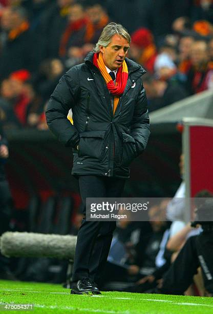 Head Coach Roberto Mancini of Galatasaray looks on during the UEFA Champions League Round of 16 first leg match between Galatasaray AS and Chelsea at...
