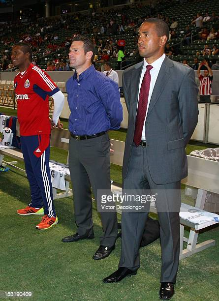 Head Coach Robin Fraser Assistant Coach Greg Vanney and Assistant Coach Carlos Llamosa of Chivas USA stand near the bench prior to the MLS match...