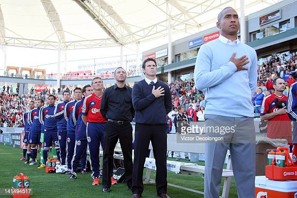 Head Coach Robin Fraser Assistant Coach Greg Vanney Assistant Coach Kevin Esparza and goalkeeper Daniel Gonzalez of Chivas USA stand for the singing...