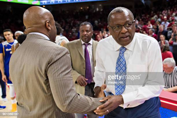 Head Coach Rod Barnes of the CSUBakersfield Roadrunners shakes hands after the game with Head Coach Mike Anderson of the Arkansas Razorbacks at Bud...