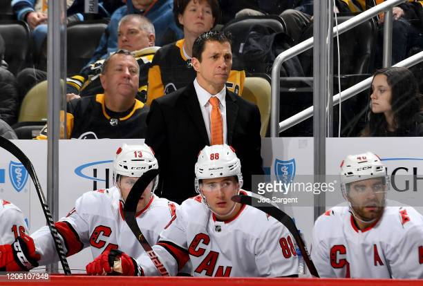 Head coach Rod Brind'Amour of the Carolina Hurricanes looks on against the Pittsburgh Penguins at PPG PAINTS Arena on March 8, 2020 in Pittsburgh,...