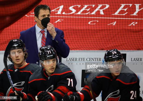 Head coach Rod Brind'Amour of the Carolina Hurricanes looks on during the first period of their game against the Detroit Red Wings at PNC Arena on...