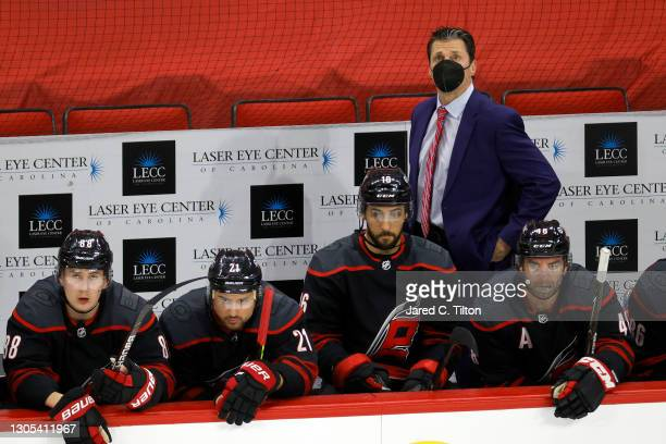 Head coach Rod Brind'Amour of the Carolina Hurricanes looks on during the third period of their game against the Detroit Red Wings at PNC Arena on...