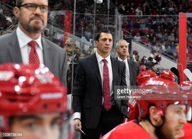Head coach Rod Brind'Amour watches his team play against the Edmonton Oilers during the second period of their game at PNC Arena on February 16, 2020...