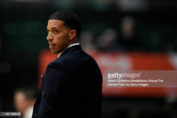 Head coach Rodney Billups of the Denver Pioneers watches the action during the first half against the Colorado State Rams on Tuesday, November 5,...