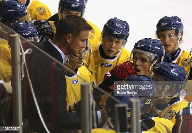 Head coach Roger Ronnberg of Team Sweden speaks with his players during a game against Team USA at the USA Hockey National Evaluation Camp on August...