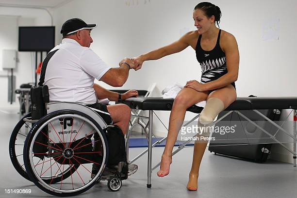 Head coach Roly Crichton talks with Sophie Pascoe of New Zealand before the Women's 100m breaststroke SB9 heat on day 10 of the London 2012...