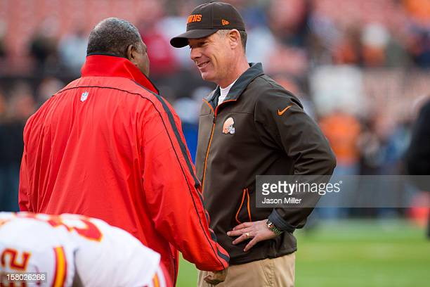 Head coach Romeo Crennel of the Kansas City Chiefs and head coach Pat Shurmur of the Cleveland Browns talk prior to the game at Cleveland Browns...