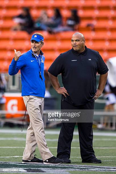 Head coach Ron Caragher of the San Jose State Spartans and interim head coach Chris Naeole of the Hawaii Warriors talk on the field before the start...